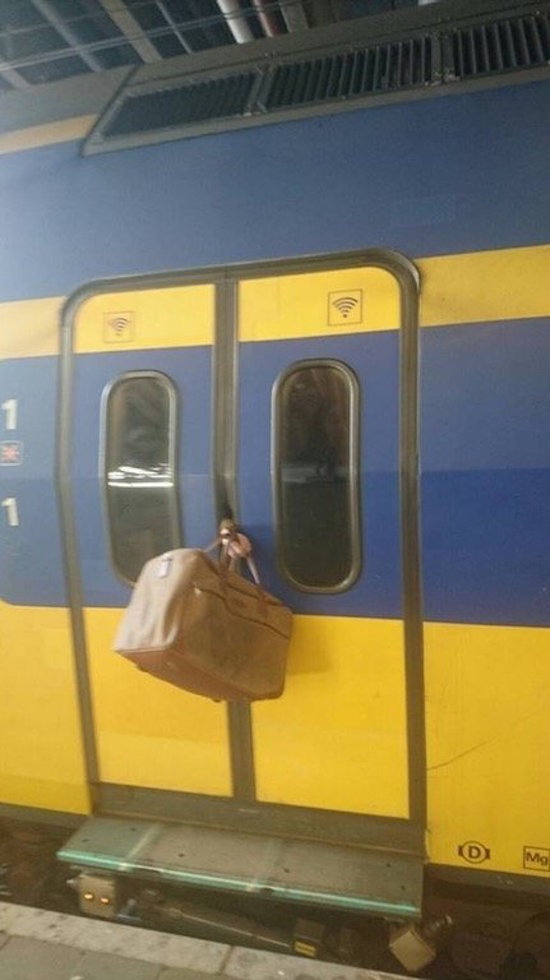 the-best-funny-pictures-of-arm-stuck-in-train-doors
